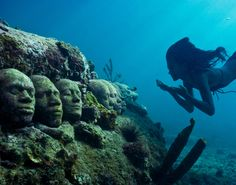 Located in Grenada's Moilinere Bay, Jason de Caires Taylor's underwater sculptures are a momument created to pay homage to the hundreds of slaves that sought freedom or were forced to jump overboard slave ships travelling through the Middle Passage from West Africa to the Americas and the Caribbean.
