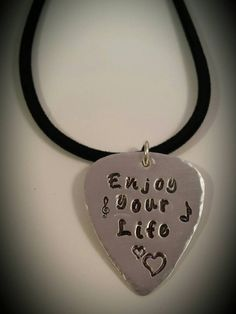 Blue October Inspired, Inspirational words Justin told us at the last show. Enjoy Your Life!   https://www.etsy.com/listing/233819986/hand-stamped-guitar-pick-necklace-blue?ref=listing-shop-header-1