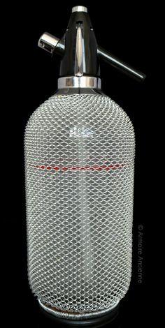 BUY on ETSY: Vintage Glass Seltzer Bottle Soda Siphon Wire Mesh Decor