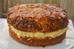 Bun-like cake with a creamy custard filling and a caramelized almond topping.