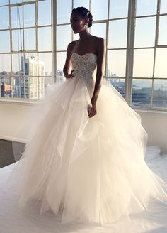 BEST DRESSES FROM FALL 2016 BRIDAL FASHION WEEK ==  Marchesa ball gown, with an intricately embroidered bodice and lush skirt made of layers of tulle, is the height of romance.