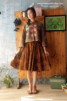 Batik Amarillis's Amarillissima jacket in Hungarian embroidery style on faux Suede & Amarilissima skirt in batik sogan sekar jagat Sragen ,it's beautiful ,unique & special ,The style is vintage 1867's Victorian wardrobe inspired, the unique style & cutting of this beautifully tailored garment will turn heads with its captivating design.Available