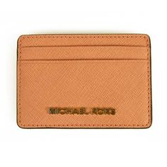 This cute and convenient Michael Kors card wallet is made of grained pale pink leather with a gold toned metallic logo on the front. There are two card slots on each side and one center pocket. Pink Leather, Card Wallet, Card Holder, Essentials, Michael Kors, Rolodex