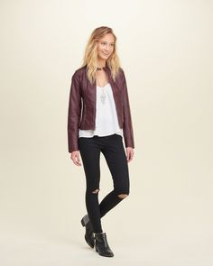 Made from soft cotton with a high rise and cropped fit, featuring hand-done destruction at knee and a five-pocket styling