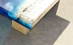 Designer Alexandre Chapelin of LA Table (previously) has been hard at work producing more tables as a part of his Lagoon series, tables that appear as aquamarine environments with secluded beaches. His recent addition is Lagoon 55, a coffee table version of his original. These tables are formed from