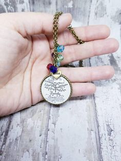 This beautifully necklace holds the birthstones of your family members set on a round family tree glass pendant with family quote Like Branches on a Tree We All Grow in Different Directions but our Roots Remain as One. The pretty birthstones vary in sizes of small, vibrant glass beads