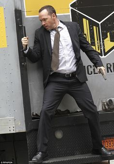 Donnie Wahlberg gets into action for his role in TV series Blue Bloods in New York City http://dailym.ai/1rdK6Sd