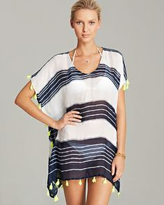 Love this poncho swim cover up with tassels