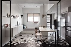 The elegant kitchen and dining area in a compact apartment