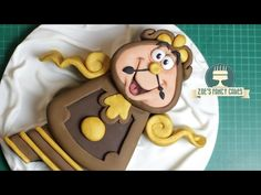 Cogsworth cake : Beauty and the Beast Disney cakes - YouTube