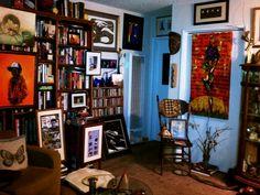 art/book filled room  home