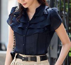 Slightly frilly dark blue blouse.