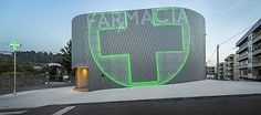 Very cool pharmacy in Portugal with neon sign incorporated into facade, farmacia lordelo in Vila Real, Portugal by Jose Carlos Cruz, Arquitecto