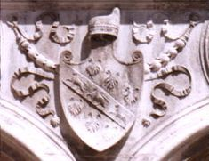 Arms of Barbarigo (Argent on a bend azure between six beards sable three lions passant or). The beards are canting, obviously. From the courtyard of the Palazzo Ducale, Venice
