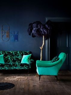 The Tango sofa in Marble Butterfly jade and Tango Chair in Estelle teal. Positioned in between them is a purple ostrich feather lamp. Introducing Matthew Williamson's first ever bespoke furniture collection. Created in collaboration with Nottingham-based World Of Interiors, Dark Interiors, Colorful Interiors, French Interiors, Feather Lamp, Feather Tree, Blue Feather, Dark Walls, Home Decor Ideas