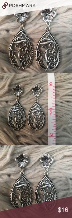 Hibiscus & Scroll Teardrop Silver Drop Earrings Gorgeous silver metal hibiscus earrings with hanging scroll pattern teardrop. Beautiful earrings with oversized backings. Unknown metal, not stamped .925. Earrings have black antiquing in the carved out portions making the detail of these really pop. 1928 Jewelry Earrings