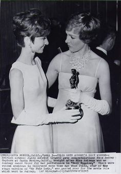 Audrey Hepburn congratulating Julie Andrews on her Oscar for Best Actress in Mary Poppins (1964)