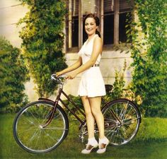 Dorothy Lamour and her Schwinn bicycle.  c.1940 I love her tap pants, halter top and look at those saddle shoes !