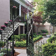 Create a Courtyard: Design your own secluded getaway. This courtyard is split into two sections -- a parterre garden and a more open lawn area -- divided by a wrought iron gate.