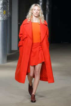 Bright Orange Short Skirt with Matching  Knee High Coat and Light Tangerine Top by Rodebjer Stockholm Fall 2017 Collection Photos - Vogue