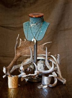Fenton & Fenton. Store display. Photo shoot. Dense layering. Neutrals and turquoise pop of display stand. Bones as jewelry stand.