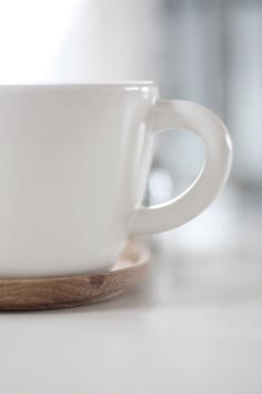 wood saucer and white teacup