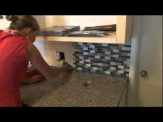 good tutorial on how to install glass tile backsplash, includes info on how to make cuts and work around outlets