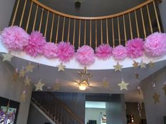 Beautiful foyer decor by Lauren from Cupcakes and Caterpillars . Our theme was twinkle twinkle little star. Perfect for my daughter's first birthday party. #goldglitter #pinkpompoms #1stbirthday