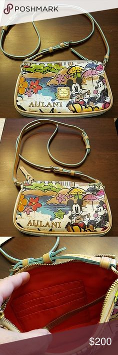 Disney Dooney Aulani bagPrice Firm Selling a gently used Disney Dooney and Burke Aulani bag. Only used once. No stains, no rips. In excellent condition. Can be used two ways, Crossbody and shoulder. You can shorten the strap. Dooney & Bourke Bags Crossbody Bags