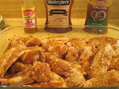 Soon to be grilled chicken wings.  Marinade ingredients in the background plus dash of butter.