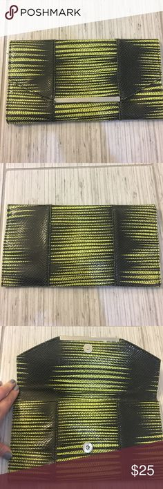 """BCBG clutch This is a BCBG lime green and black pattern clutch. Approximately 10""""x6"""".  Gently used BCBG Bags Clutches & Wristlets"""