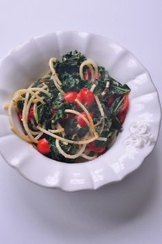Vegan kale alfredo with spaghetti and cherry tomatoes