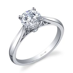 Tapered Solitaire Engagement Ring with Small Diamond Accents.
