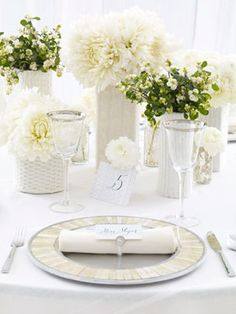 I love how all-white table settings look, especially with these fabric wrapped vases