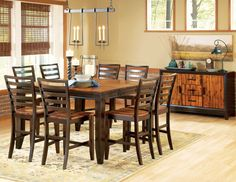 Counter height leg table is constructed of Acadia solid hardwood Table top, chair seats and sideboard front feature a solid wood butcher block design Table includes an 18