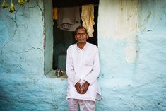 Banwali Ram, a member of the religious Ramnami sect, waiting for a 9-day local festival to start in honor of the Hindu god Ram.