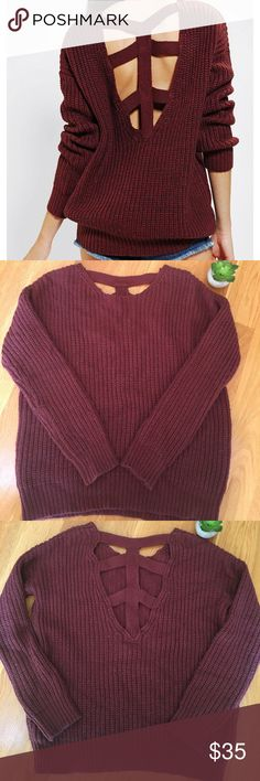 """UO SPARKLE & FADE Cross Back Maroon Sweater S Stylish and comfortable sweater! Super cute to add a touch of sexiness to a fall look. The sweater is pre-owned so it does have some signs of wear in the fabric, but it does not have stains or marks. Approx measurements : across chest flat from pit to pit is 22"""", sleeve from pit to hem is 18"""", length 24"""" Urban Outfitters Sweaters Crew & Scoop Necks"""