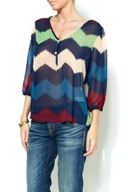 I really want a Chevron print item but can this work for a 60 year old?