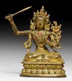 MANJUSHRI.  Tibetochinesisch, um 1800, H 17,5 cm.  Teilvergoldete Kupferlegierung mit Korallen und Glaseinlagen. Der Bodhisattva der Weisheit im Lotossitz, sein Schwert schwingend. Die Linke ist in der Geste der Argumentation erhoben. Der Lotos neben seiner Schulter trägt das Prajnaparamita-Sutra und ist separat gegossen. Schwertklinge ersetzt. Tibetan Art, Tibetan Buddhism, Buddhist Art, Oriental, Buddha Statues, Antiquities, Himalayan, Asian Art, Nepal