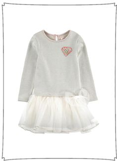 Top: Cotton fleece Mini skirt: Polyester tulle Satin lining Pleasant to the touch Crew neck Raindrop opening in the neck Long sleeves Gathered waistband Button in the neck Fancy bow Lurex thread Detac
