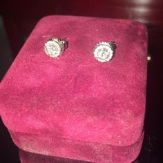 1/2 carat 14k halo diamond studs Certified .49 ctw diamond stud earrings set in 14ct white gold and surrounded by .06 carat diamond halo settings. These are appraised at $2150. Lifetime warranty included. Serious inquiries only please. Jewelry Earrings