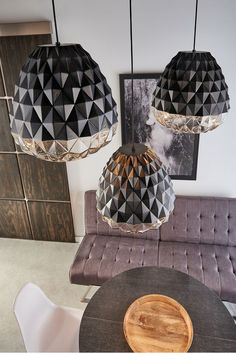 Sophisticated elegance exudes from the Facette Grande pendant light from LBL Lighting. Light flows through hundreds of triangular facets at the bottom of the shade, with the upper portion masked with textured paint to create depth and dimension.