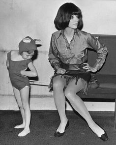 Joan Collins accidentally sits on the 'tail' of her five-year old daughter Tara's mouse costume. (Photo by Keystone/Getty Images)