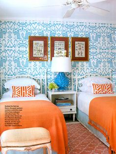 love the pool blue with bright orange:  china seas wallpaper; orange throws from Bamboo-Bamboo; linens from Matouk; rug (Madeline Weinrib)