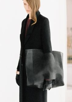 & OTHER STORIES Made from a combination of smooth suede and leather that has a faint crinkled look, this shopper has an open pocket on one side that allows it to also be carried as an oversized clutch bag