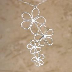 Handmade sterling silver Daisy flowers cascade from a 16'' sterling chain with handmade sterling silver hook and eye clasp. He...