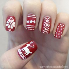 My go at Christmas nails. Glad I'm only putting up my left hand… the right one looks like crap ;)  Red: Really old Jazy brand redWhite: Acrylic paint  See more of my nails at currentfixation.tumblr.com:)