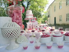 Details of the dessert table for this heart themed party in pink and red