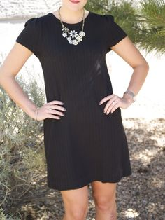 unique necklace paired with simple black dress #anthropologie