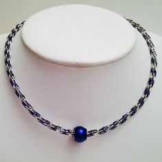 Ladies navy and bright silver viking knit necklace with slider bead by DonnaDStore on Etsy